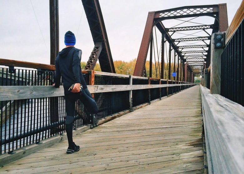 Running in winter on a bridge